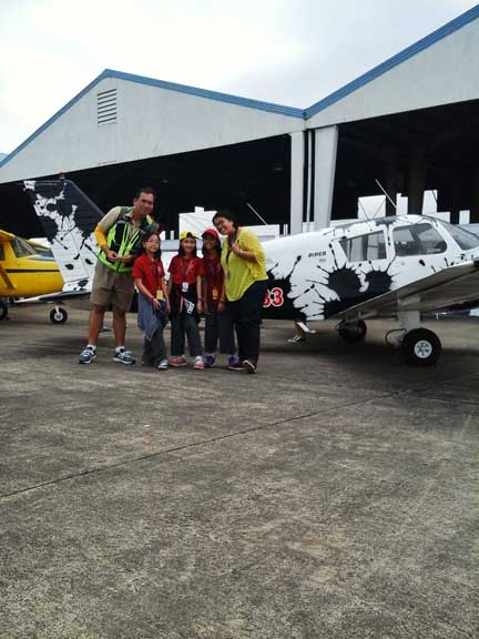 Prof. Mel Silvestre happy to usher us into the boundless world aviation. Here he is in front of a vintage airplane with the Grade 2 students and Teacher Nemcy Cruz.
