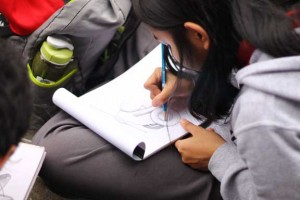 Alicia Cruz drawing a pilot airplane. Yes, you heard it right!